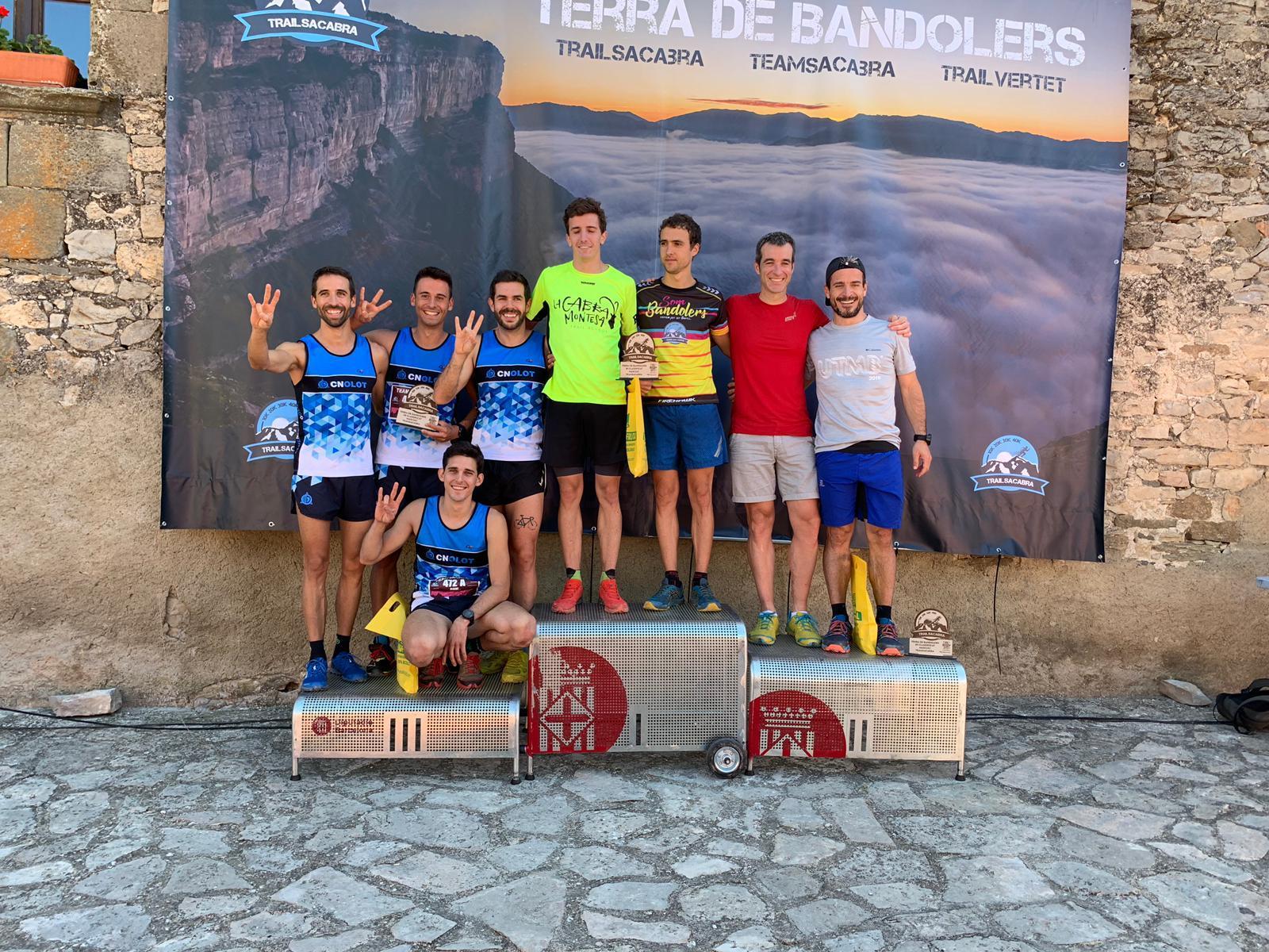 Marc Vilamanya, Albert Alquezar, Miquel Campderrich i Joel Vila fent podi durant la Trailsacabra 2019